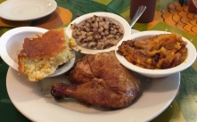 Rotisserie smoked chicken, corn bread, sweet potato casserole and black-eyed peas.